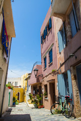 Türaufkleber Schmale Gasse Beautiful typical street in Chania, Crete (Greece). Vertical summer shot. Colorful architecture, charming narrow alley. Summer sunny day.