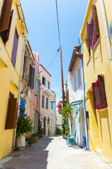Beautiful typical street in Chania, Crete (Greece). Vertical summer shot. Colorful architecture...