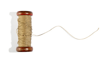 Wooden vintage reel of twine on white