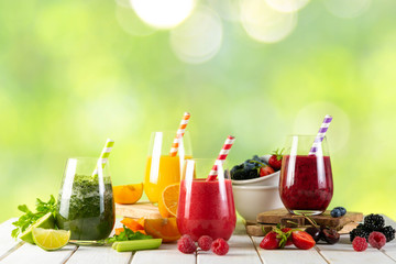 Selection of colorful smoothies and ingredients in glasses, rustic background Wall mural
