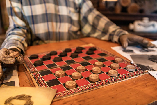 Wax figure of person playing checkers. Interactive museum of wax figures in Kootenays, British Columbia, Canada. Leisure activities of rural people