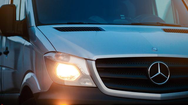 Berlin, Germany - January 29, 2020: Passenger van Mercedes-Benz Sprinter. Front grill, logo and headlights.