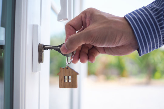 Landlord unlocks the house key for new home.