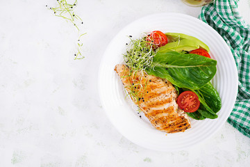 Chicken grilled fillet with salad fresh tomatoes and avocado. Healthy food, ketogenic diet, diet...