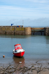 red boat in mouse hole harbour cornwall uk