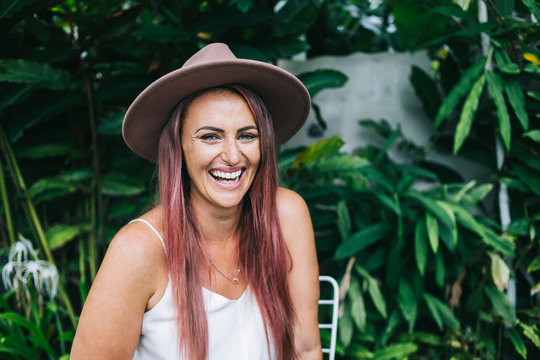 Gorgeous laughing woman looking at camera in garden