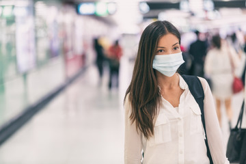 Coronavirus Asian woman walking with surgical mask face protection walking in crowds at airport...