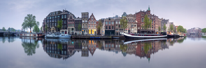 Fotobehang Amsterdam Cityscape of Amsterdam with reflection of buildings on water