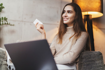 Girl using bank card for buying things online. Retail stores offering bonus cards for customers. Select items in web shop app, transfer money safely using sms code for payment. Money refund guarantee.