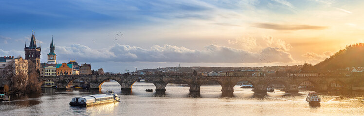 Prague, Czech Republic - Panoramic view of the world famous Charles Bridge (Karluv most) on a sunny winter afternoon with beautiful golden sunset and sky