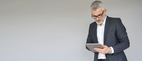 Businessman using digital tablet isolated on background- template Fotobehang