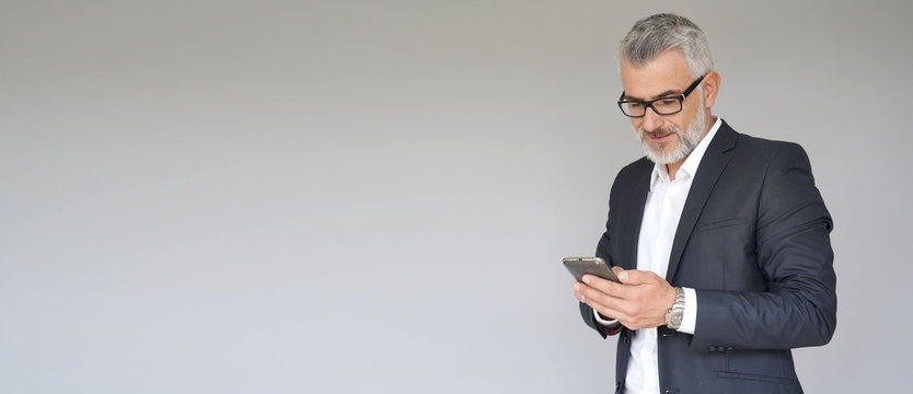Businessman using smartphone, isolated on background - template