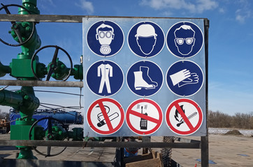 mandatory signs are on gas well fence