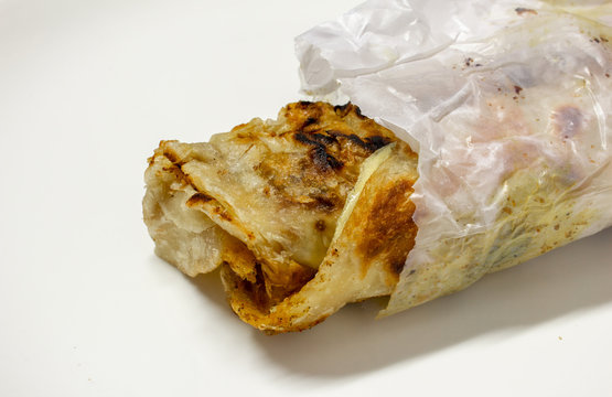 Parotta roll which is a common street food in south india. Partotta is a layered flatbread made out of maida flour.