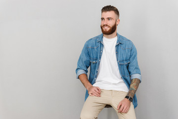 Portrait of a handsome young man wearing casual clothes Wall mural