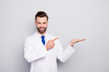 Portrait of his he nice attractive cheerful cheery confident doc holding on palm showing copy space...