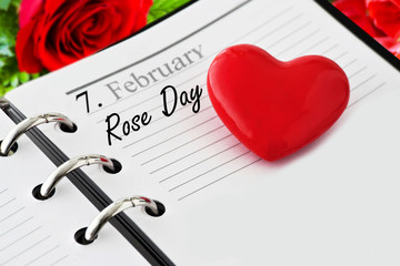 Calendar with heart and Rose Day in February