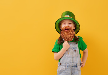 girl in leprechaun hat Wall mural