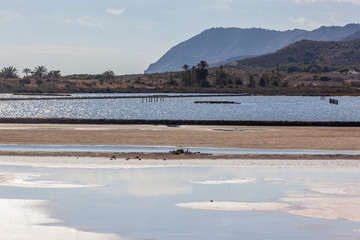 Salty lakes and sandy shallow surrounded with mountains located within of the Calblanque Regional natural Park, Murcia, Spain
