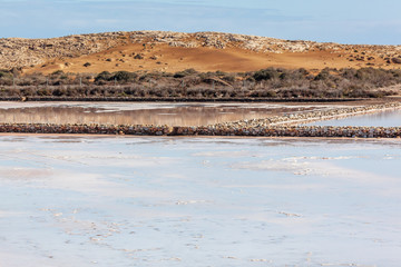 Scenic view of pink mirror-like salt pools located within Calblanque Regional natural Park, Murcia, Spain