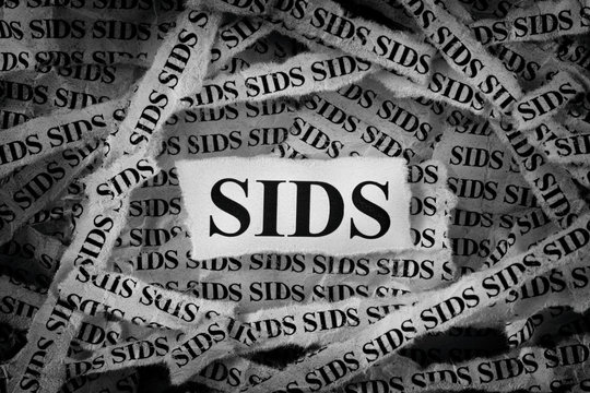Strips of newspaper with SIDS typed on them (Sudden Infant Death Syndrome)
