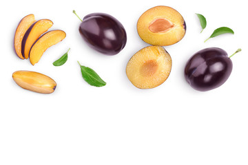 fresh purple plum and half with leaves isolated on white background with clipping path and copy spase for your text. Top view. Flat lay Wall mural