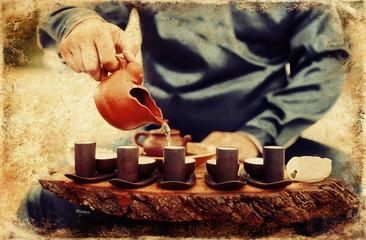 Tea ritual. Old photos effect with border.