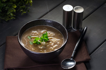 Hot mushroom soup with noodles. Small depth of field.