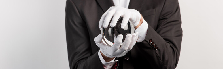 cropped view of professional magician holding magic ball, isolated on grey, panoramic shot Wall mural