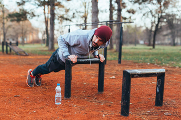 young man outdoor workout in outdoor gym