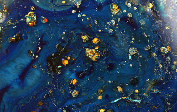 Macro mystical Abstract blue color marble texture background. Acrylic color in water and oil.