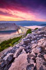 Papiers peints Prune Dramatic summer seascape of Adriatic sea. Bigger arch Bridge to Krk Island at sunrise, near Maslenica, Croatia, Europe. Bridge connects the Croatian island of Krk with the mainland. Morning light. .