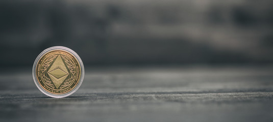 Ethereum Cryptocurrency on black wooden background