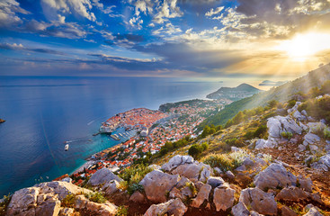 Aerial view at famous european travel destination in Croatia, Dubrovnik old town, Dalmatia, Europe. UNESCO list. Beautiful sunset view over the historic old town Fort Bokar seen in dramatic light.