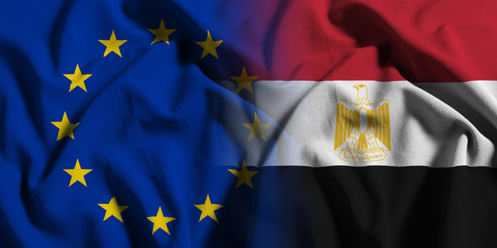 National flag of Egypt with European Union (EU) flag on a waving cotton texture background