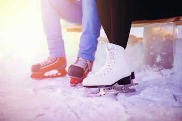 Ice skating lover couple having fun on snow winter holidays night illumination