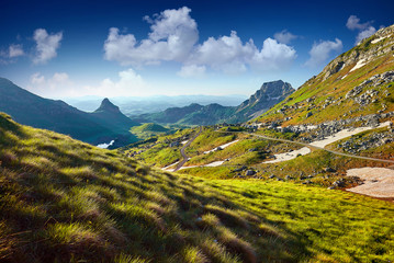 Amaizing sunrise view on Durmitor mountains, National Park, Mediterranean, Montenegro, Balkans, Europe.  Bright summer view from Sedlo pass. Instagram picture. Way through the mountain.