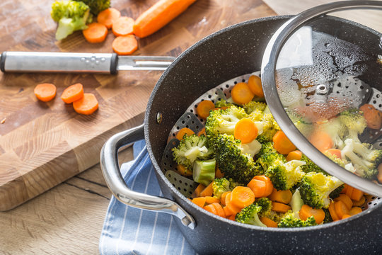 Steamed mixed vegetable in black pot. Healthy vegetable concept
