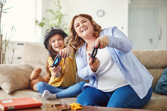 child daughter mother family happy playing console kid childhood