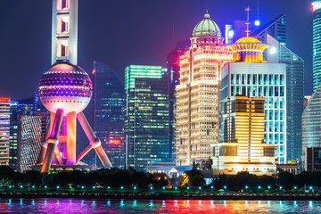 Lujiazui Financial District skyline with Oriental Pearl Tower by night in Shanghai city, China