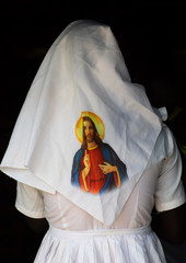Mundari tribe nun with jesus christ on her veil during a sunday mass in a church, Central Equatoria, Terekeka, South Sudan