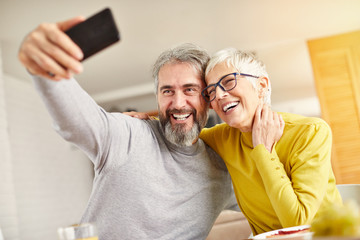 senior couple mobile phone happy cellphone selfie picture photo