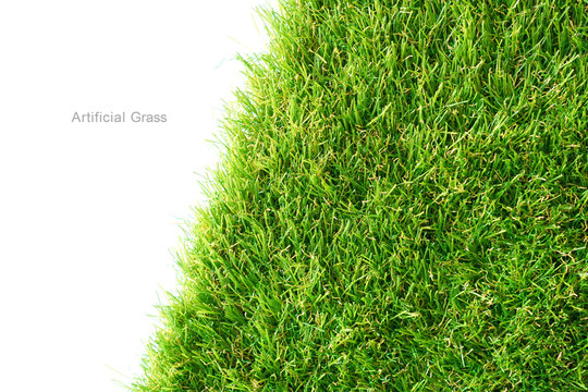 Green artificial grass on a white background, copy space.