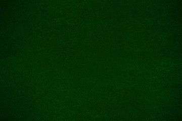 fleecy fabric background of felted texture, dark green cloth for poker table