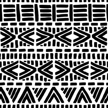 Black and white seamless pattern. Geometric ink hand-drawn ornament. Ethnic and tribal motifs. Striped print for textiles, wrappers, packaging. Vector illustration.