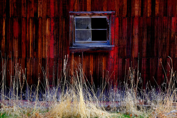 Old Barn in Field in Late Fall Autumn Brown Grass Weathered Red Wood