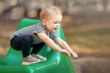 Little boy sports training her balance on chair edge