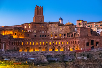 Rome, Italy - Evening view of the Roman Forum - Foro Romano - with Trajan's Forum, Trajan's Market and the Torre delle Milizie tower