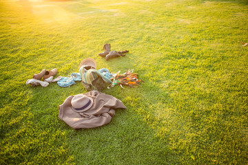 Summer clothes laying on the grass.