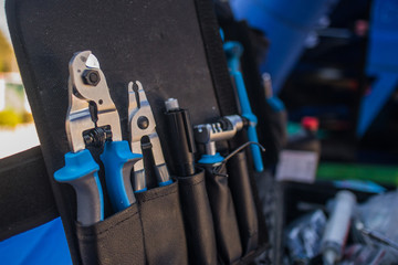 Foto op Aluminium Fiets An assortment of modern blue coloured bicycle tools in a tool box or pouch on a work bench.